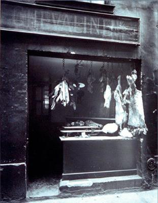"<em>Boucherie, Rue Christine,</em> 1923-24<br />Gelatin silver print<br />Image: 9 1/8 x 6 7/8""; Mount: 12 15/16 x 10"""
