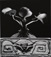 Jerry Uelsmann (b. 1934)<br><em>Untitled (Flower on cherub stand)</em>, 1968</br>Vintage gelatin silver print