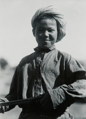 "<em>Untitled (Boy in Turban)</em>, nd<br>Gelatin silver print</br>Image: 4 1/4 x 3 1/8""; Paper: 5 1/2 x 3 1/2"