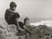 <em>Untitled (Boy sitting on rock with seabird),</em>c. 1950s/1960s<br />Gelatin silver print<br />Image: 12 x 9""