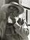 "<em>Untitled (Man in Overalls Standing Outside Building),</em>c. 1950s/1960s<br />Gelatin silver print<br />Image: 11 1/8 x 8 3/4"""