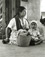 """<em>Untitled (Woman with, basket and child),</em>c. 1950s/1960s<br />Gelatin silver print<br />Image: 12 1/8 x 9 1/2"""""""